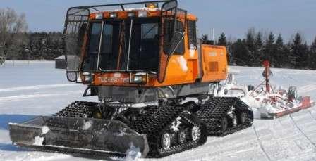 Икона среди снегоходов Tucker Sno-Cat. Современное исполнение, укладчик лыжни